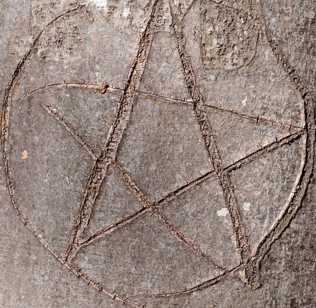 pentagram-scratched-into-floor-under-bed